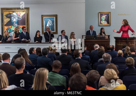 London, UK. 28th Feb, 2018. Auctioneer Helena Newman (pictured in red dress) takes the Impressionist and Modern - Stock Photo