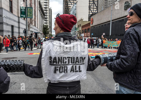 San Francisco, USA. 28th February, 2018. Protesters form a human chain at a San Francisco intersection in protest. - Stock Photo