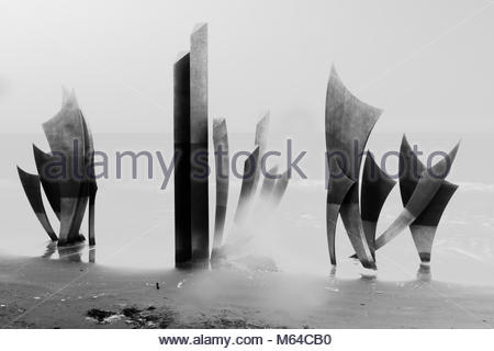 Omaha beach memorial on a rainy day in black and white - Stock Photo