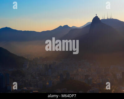 Sunset view of the mountains with Christ the Redeemer, Rio De Janeiro - Stock Photo