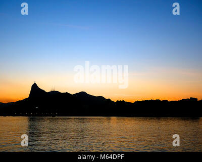 Sunset view of the mountain with Christ the Redeemer, Rio De Janeiro - Stock Photo