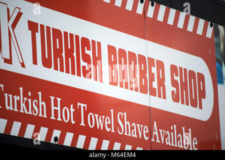 turkish barber shop sign on a store in the uk - Stock Photo