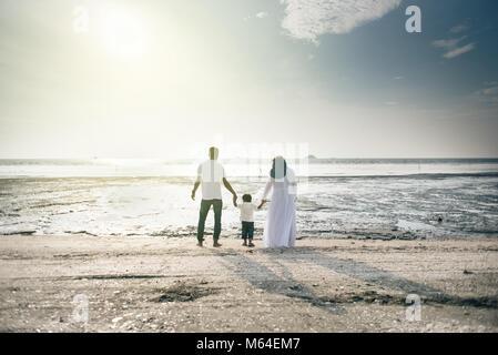 happy family having fun time together at the beach having nice sunset view located in Pantai Remis,Kuala selangor,selangor,malaysia. - Stock Photo