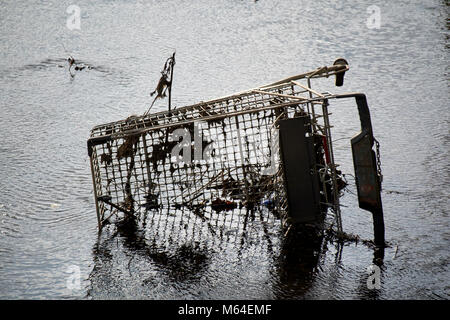 shopping trolley dumped in a river in the uk - Stock Photo