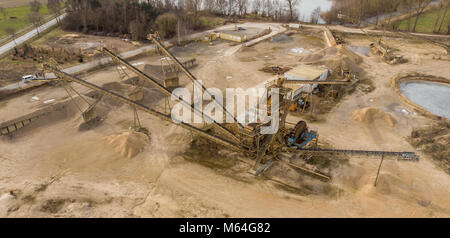 Oblique aerial photograph with the overall view of a large processing machine when used in a sand quarry, to divide - Stock Photo