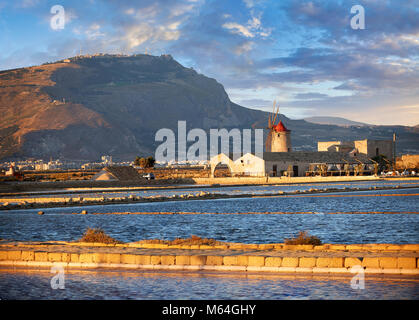 Pictures & images of the salt pans of the Nubia Salt works Museum and Nubia wind mill with Erice on the hills behind, - Stock Photo