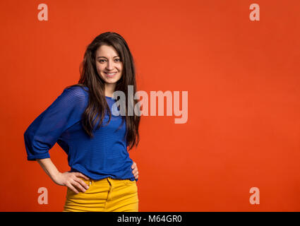 Portrait of a young beautiful woman in studio. - Stock Photo