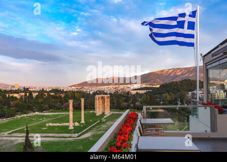 Greek flag and Olympieion in Athens, Greece - Stock Photo