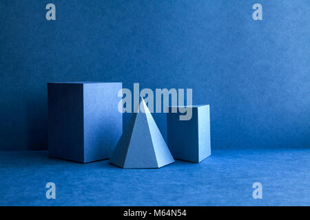 Geometrical figures still life composition. Three-dimensional prism pyramid tetrahedron rectangular cube objects - Stock Photo