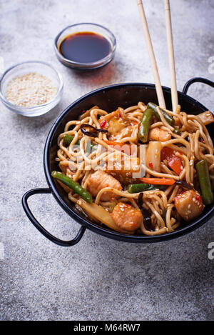Stir fry noodles with chicken, tofu and vegetable.   - Stock Photo