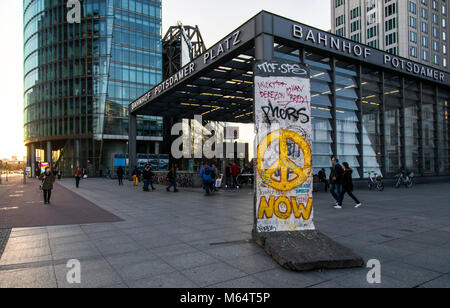 Entrance to the Potsdamer Platz station, Deutsche Bahn Group headquarters, part of the former Berlin Wall, Germany - Stock Photo