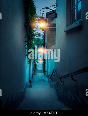 Romantic street of the old town in Warsaw at night, Poland - Stock Photo