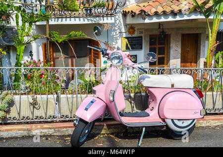 TAORMINA, ITALY - OCTOBER 1, 2017: Pink scooter in street of Taormina in Sicily - Stock Photo