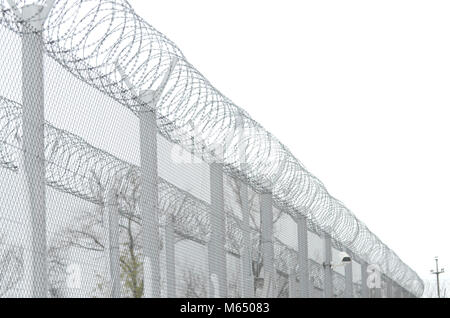 Details of high security prison on winter day - Stock Photo