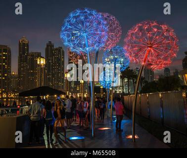 26th December 2017 - Dubai, UAE. People enjoying warm evening in colorful Burj square. - Stock Photo