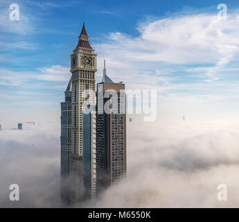 26th December 2017 - Dubai, UAE. Skyscrapers appearing from heavy fog early in the morning. - Stock Photo