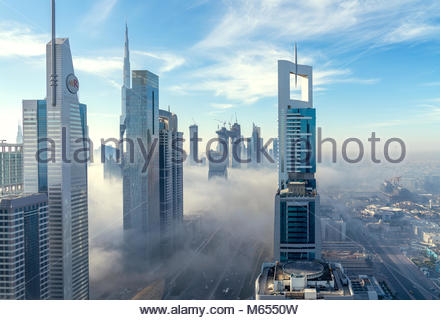 26th December 2018 - Dubai, UAE. Spectacular view of a Financial center covered with fog. - Stock Photo