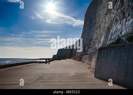 Undercliff Walk path for walkers and cyclists at the foot of protected white chalk cliffs near Brighton in East - Stock Photo