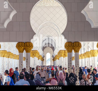 28th December 2017 - Abu Dhabi, UAE. Tourists visiting gorgeous Sheikh Zayed mosque during winter holidays. - Stock Photo