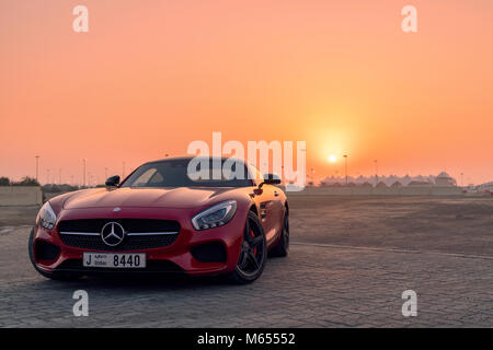 28th December 2017 - Abu Dhabi, UAE. Red Mercedes SLS GTs in front of a beautiful sunset. - Stock Photo
