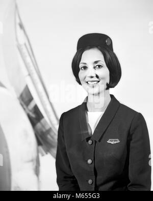 1960s SMILING FEMALE STEWARDESS FLIGHT ATTENDANT LOOKING AT CAMERA - a7414 HAR001 HARS FEMALES JOBS FLIGHT ONE PERSON ONLY HALF-LENGTH LADIES CARING RISK PROFESSION CONFIDENCE NOSTALGIA EYE CONTACT 20-25 YEARS SKILL OCCUPATION SKILLS CHEERFUL ADVENTURE JET COURAGE CAREERS PRIDE OPPORTUNITY AUTHORITY EMPLOYMENT SMILES JOYFUL RESPONSIBILITY RESPONSIBLE EMPLOYEE ATTENDANT FLIGHT ATTENDANT HOSTESSES MEMBER STEWARDESS YOUNG ADULT WOMAN AIR HOSTS AIRCREW B&W BLACK AND WHITE CABIN ATTENDANTS CABIN CREW CAUCASIAN ETHNICITY EMPLOYED FLIGHT ATTENDANTS LOOKING AT CAMERA OCCUPATIONS OLD FASHIONED PERSONS