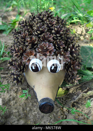 Hedgehog made from a plastic bottle and cones - Stock Photo