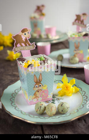 Easter table setting with French vintage plates - Stock Photo