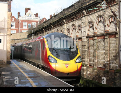 Class 390 Pendolino electric multiple unit train operated by Virgin West Coast leaving Crewe railway station on - Stock Photo