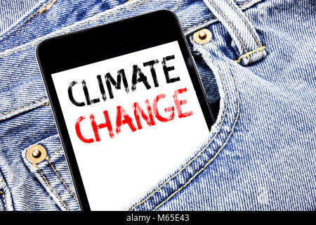 Handwriting Announcement text showing Climate Change. Business concept for Global Planet Warming Written phone mobile - Stock Photo