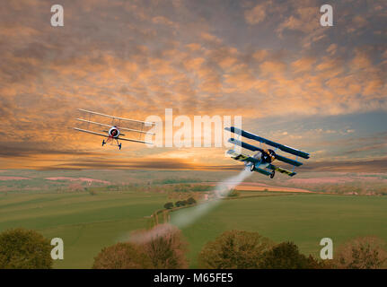 Digitally altered image of a world war 1 dogfight over open countryside - Stock Photo