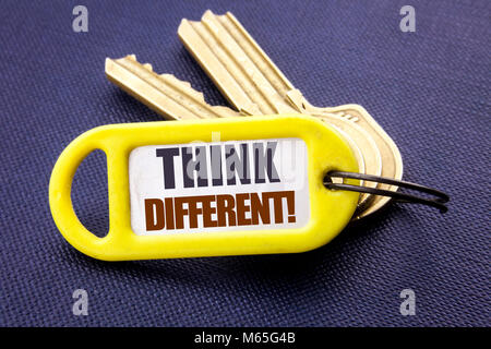 Handwriting Announcement text showing Think Different. Business concept for Outside Box Creative Written key holder - Stock Photo