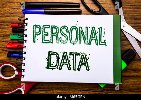 Conceptual hand writing text Personal Data.  Concept for Digital Protection Written on notebook, wooden background - Stock Photo