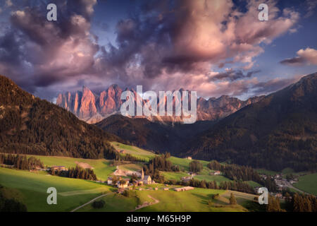 Idyllic landscape photo of village Santa Maddalena with a view on Geisler or Odle high mountain peaks at colorful - Stock Photo