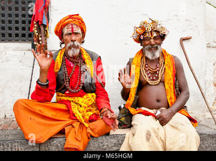 KATHMANDU, NEPAL - MAY 18: Holy Sadhu men with traditional painted face, blessing in Pashupatinath Temple. May 18, - Stock Photo