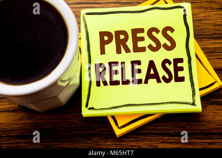 Handwritten text showing Press Release. Business concept for Statement Announcement Message written on sticky note - Stock Photo