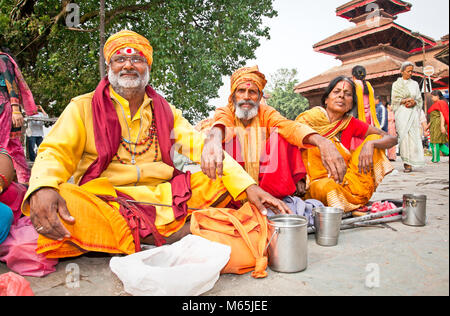 KATHMANDU, NEPAL - MAY 19: Holy Sadhues  with traditional blessing in Durbar Square on May 19, 2013 in Kathmandu, - Stock Photo