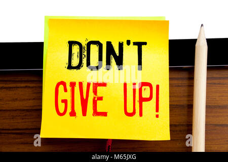 Hand writing text caption inspiration   Don t Give Up. Business concept for Motivation Determination, written on - Stock Photo