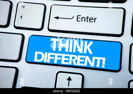 Handwriting Announcement text showing Think Different. Business concept for Outside Box Creative written on red - Stock Photo