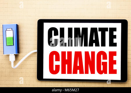 Handwriting Announcement text showing Climate Change. Business concept for Global Planet Warming Written on tablet - Stock Photo