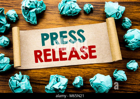 Word, writing Press Release. Business concept for Statement Announcement Message Written on sticky note paper, wooden - Stock Photo