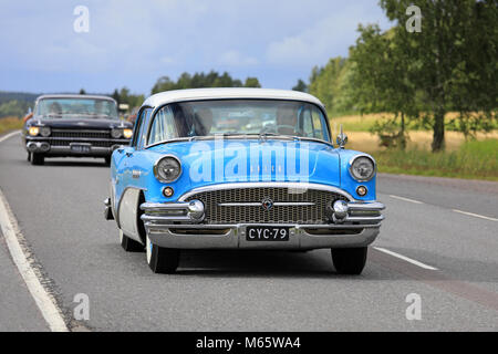 SOMERO, FINLAND - AUGUST 5, 2017: Classic Buick Special 4-door sedan moves along rural highway with other classic - Stock Photo