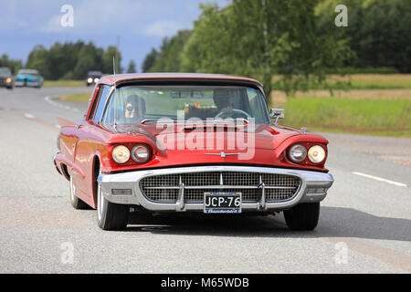 SOMERO, FINLAND - AUGUST 5, 2017: Red Thunderbird hardtop 1960 classic car moves along rural highway on Maisemaruise - Stock Photo