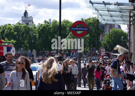 Crowd of people near entrance to Westminster tube station on sunny summer day in London,United Kingdom. - Stock Photo