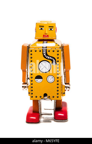 Vintage tin robot toy isolated on a white background. - Stock Photo