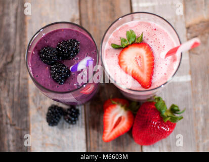 Healthy Eating. Berry smoothies, milkshakes made with fresh blueberries and strawberries in a glass - Stock Photo
