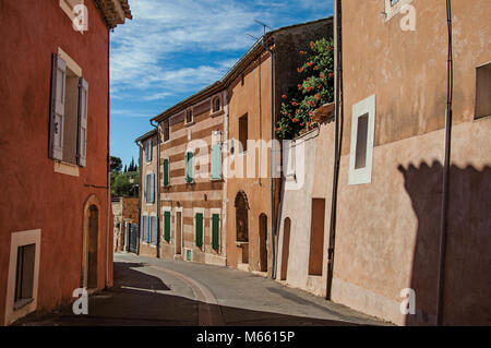 View of traditional colorful houses in ocher and street at the Roussillon village. Located in the Provence region, - Stock Photo