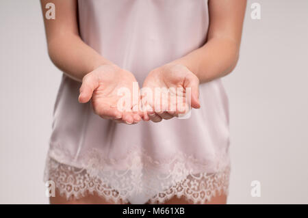Female hands. Woman showing her palms. Beauty concept. - Stock Photo