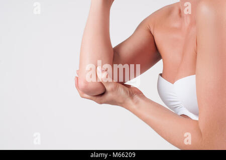 Body care. Female elbow. Pain in the joints of the hands - Stock Photo