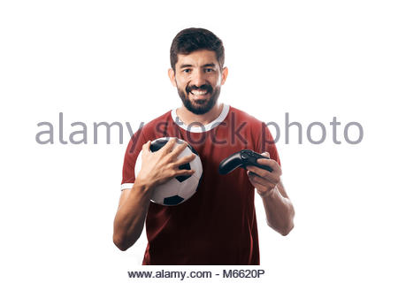 Football or soccer fan wearing neutral uniform and holding a ball and a joystick on white background - Stock Photo