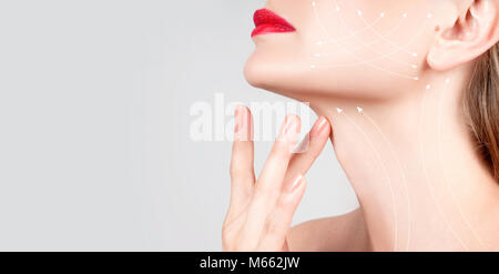 Anti-aging treatment and face lift. Beautiful woman neck with massage lines or lifting arrows - Stock Photo